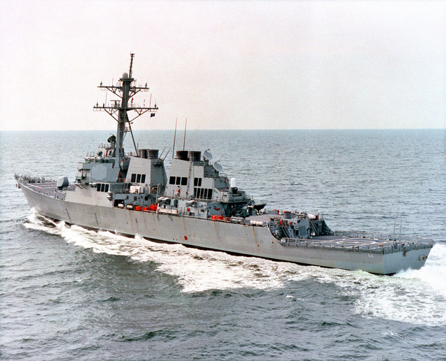 A port quarter view of the guided missile destroyer USS GONZALES (DDG 66) underway during builder's sea trials