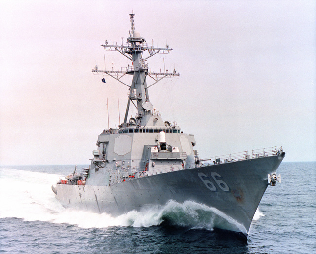 A starboard bow view of the guided missile destroyer USS GONZALES (DDG 66) underway at high speed during builder's sea trials