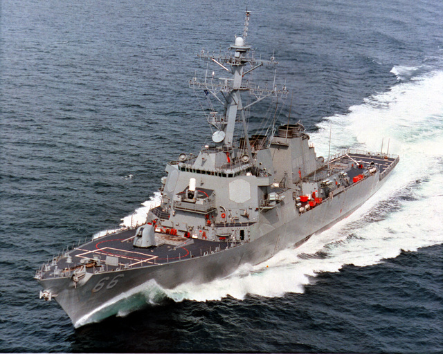 An aerial port bow view of the guided missile destroyer USS GONZALES (DDG 66) underway at high speed during builder's sea trials