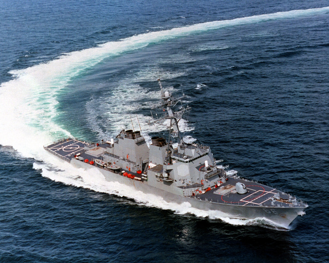 An aerial starboard bow view of the guided missile destroyer USS GONZALES (DDG 66) executing a high speed turn during builder's sea trials
