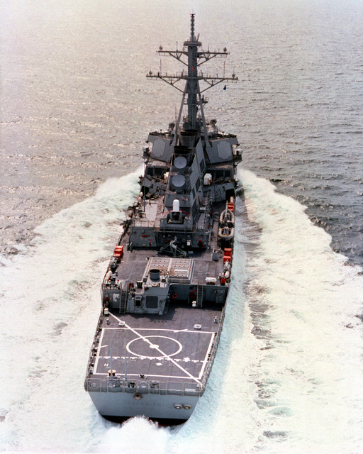 An aerial stern-on view of the guided missile destroyer USS GONZALES (DDG 66) underway at high speed during builder's sea trials