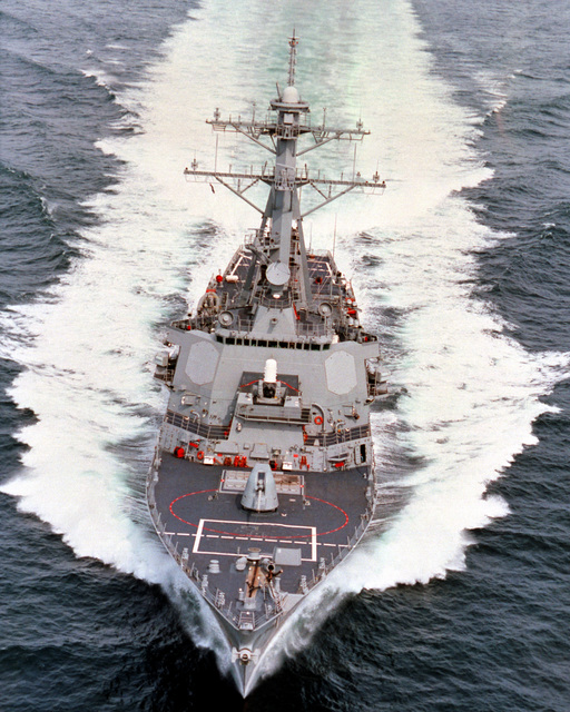 An oblique bow-on view of the guided missile destroyer USS GONZALES (DDG 66) underway at high speed during builder's sea trials