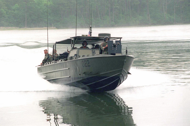 A Riverine Assault Craft (RAC) belonging to Small Craft Company, 2d Marine Division, patrols the New River