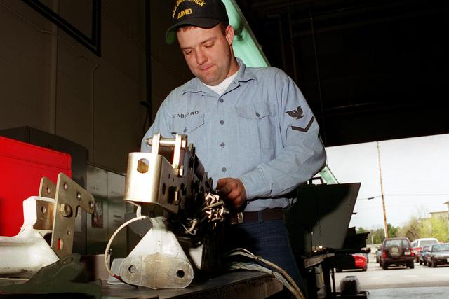 Aviation Ordnanceman Second Class (AO2) Jason Gabbard is doing a 224 day inspection on a BRU-14 bomb rack in the 710/ordnance shop