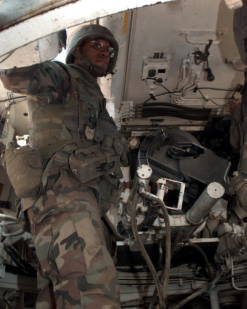 SPC William Coleman stands at the ready in an M-109A3 155mm self propelled howitzer at McGill Base (Grid 171726) were his unit, A Battery of the 2-3 Field Artillery, is deployed. A Battery supports units in the 1ST Brigade, 1ST Armor Division area, which is part of the NATO Implementation Force (IFOR), in Bosnia-Herzegovina during Operation Joint Endeavor