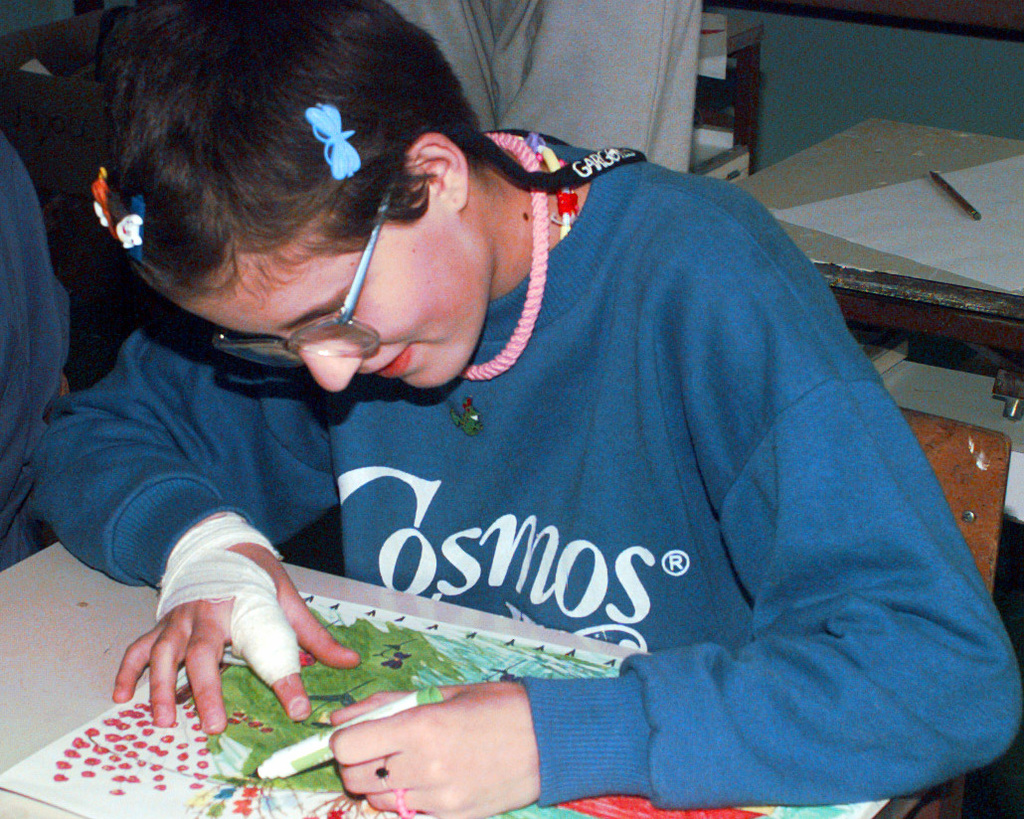 Zorica Milonovic, a mentally retarded student at Mjedenica School, uses art supplies donated by pre-school students in South Kingstown, Rhode Island, during Operation Joint Endeavor