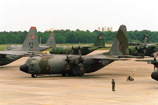A Royal Air Force C-130 parked on the ramp with C-130's from other countries, prepares for the launch of three formations of 57 C-130's for Big Drop III Exercise, the largest peacetime single day airdrop since World War II