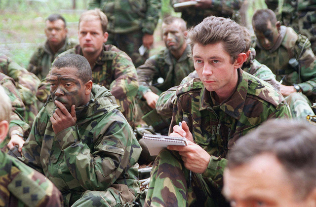 GUNNERY SGT. Adam Terry (left), Weapons Platoon, 3rd Battalion, 8th Marine Regiment, 2d Marine Division and British Royal Marine LT. Ed Robinson 5th Battalion 9th Marine Regiment Independent Commando Squadron, Royal Engineers, take notes and plot grids during warning order