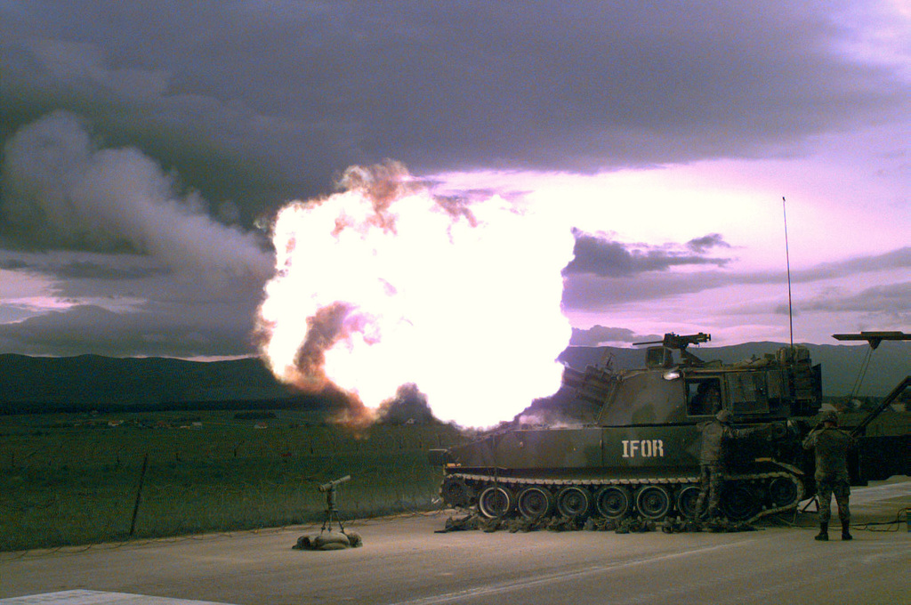 On the evening of May 20th, an M-109A2 155mm self propelled Howitzer fires a shell near Glamoc, Bosnia- Herzegovina, during a live fire exercise in support of Operation Joint Endeavor. The Howitzer, belongs to Bravo Battery, 4th Battalion, 29th Field Artillery
