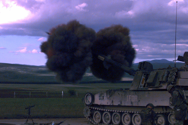 On the afternoon of May 24th, 1996, an IFOR (Implementation Force) M-109A2, 155mm, self propelled Howitzer, belonging to 1ST Platoon, B Battery, 4th Battalion, 29th Field Artillery, fires a round during a live fire exercise near Glamoc, Bosnia-Herzegovina (XJ 5282), in support of Operation Joint Endeavor