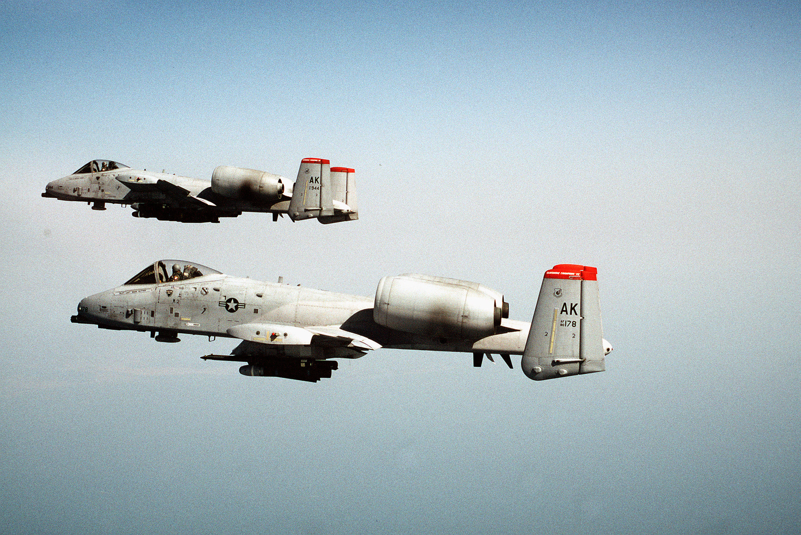 A-10 Warthogs from the 355th Fighter Squadron, Eielson Air Force Base, Alaska, fly over the coast at the Kunsan Bomb Range. The A-10s are returning from a live ordnance bomb drop. The 355th Fighter Squadron is the 1995 Top Guns at Gunsmoke '95