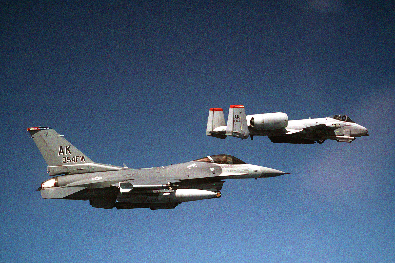 An F-16 Falcon from the 18th Fighter Squadron and a A-10 Warthog from the 355th Fighter Squadron, both from Eielson Air Force Base, Alaska, fly over the coast at the Kunsan Bomb Range a bombing exercise. The aircraft are returning from a live ordnance bomb drop. The exercise was to use up some of the old Vietnam Era ordnance that was still in the Air Force inventory