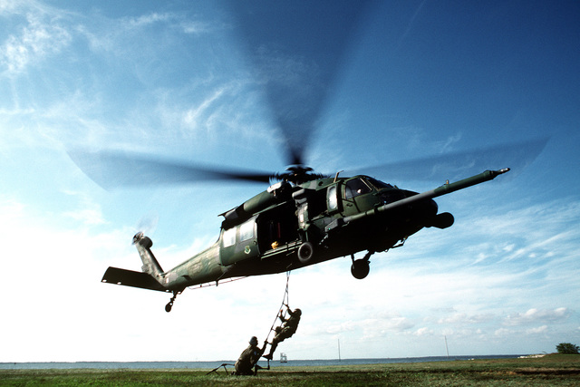 Pararescuemen from the 1ST Rescue Group perform training certification on an HH-60G Pave Hawk helicopter assigned to the 41st Rescue Squadron. The newly assigned Pararescuemen, SENIOR AIRMAN Mario Romero and AIRMAN 1ST Class Eric Castor must certify on the fast rope and ladder climb