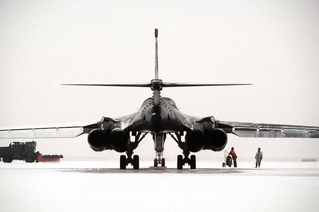 Rear view of a B-1B Lancer as a snow plow clears the runway