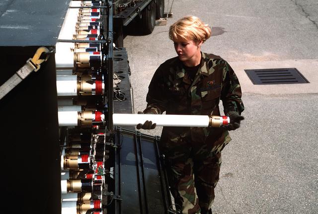 SENIOR AIRMAN Sarah Esparza, 51st Maintenance Squadron, inspects 2.75 White Phosphorous Rockets
