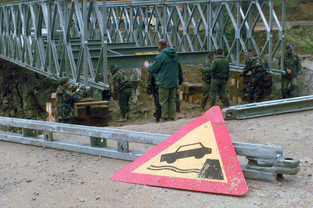 Several miles from the city of Sarajevo, Bosnia, a detachement of Hungarian Army Engineers finish assembling a Mabey Johnson 200 bridge before moving it into position as part of Operation JOINT ENDEAVOR. The bridge will allow easier vehicular traffic access throughout the surrounding area. Beginning in December, 1995, US and allied nations deployed peacekeeping forces to Bosnia in support of JOINT ENDEAVOR. Romania is one fourteen Partnership for Peace (PfP) countries that participated in the NATO lead peace mission that includes providing a safe environment