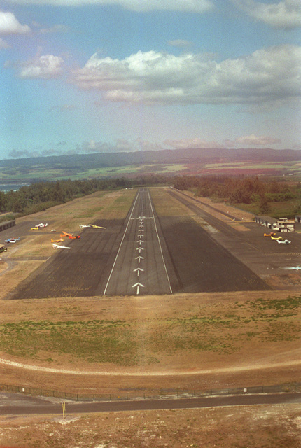 Looking east, this is the final approach to the 9,000 foot runway at Dillingham Air Field on the northwest corner of the island. This former Air Force fighter base is now used by the Air Force parachute team and flying club as a training site. The field is available to all services as a subsidiary emergency landing site