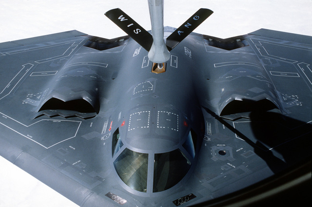 """A B-2 """"Spirit"""" stealth bomber, from the 509th Bomb Wing, Whiteman Air Force Base, Mo., approaches the refueling boom of a KC-135R tanker from the 128th Refueling Wing, 128th Air National Guard, Milwaukee, Wis"""