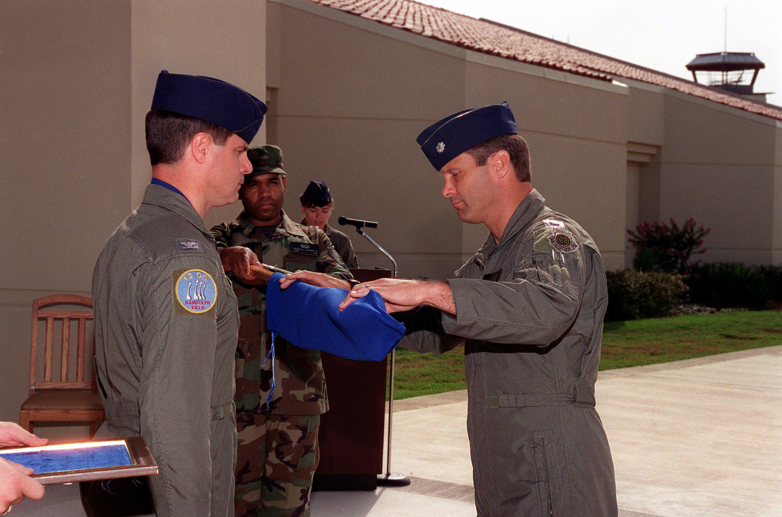 At the deactivation of the 563rd Flying Training Squadron, LT. COL. Holloway covers the unit's guidon. The 453rd Electronic Warfare School and Systems Squadron came from Mather Air Force Base, Calif. Both schools were combined and formed the 563rd here at Randolph Air Force Base. The 563rd's mission was flying instruction and graduate level electronic warfare