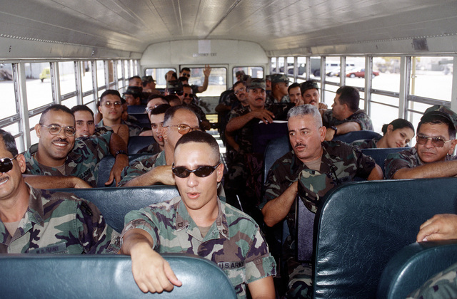 Members of the 770th Military Company, Army National Guard, Aquadilla, Puerto Rico, wait on a bus to be transported to their billeting area at Biggs Army Airfield, El Paso, TX. The 770th is participating inRoving Sands '96, the largest annual US joint air defense training exercise