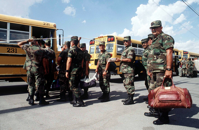Members of the 770th Military Company Army National Guard from Aquadilla, Puerto Rico, board buses at Biggs Army Airfield in El Paso, Texas, to be transported to their billeting area. The 770th is in Texas to take part in Exercise ROVING SANDS '96