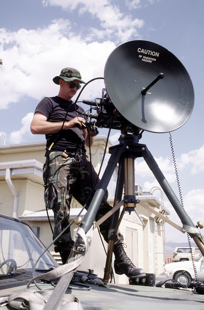 Communications Repair Technician, SSGT. Shawn Cordray, 255th Air Control Squadron, Air National Guard, Gulfport, MS, performs an operations check on the Tropo Satellite Support Radar. The Tropo Satellite Support Radar provide telephone communication for units competing in Roving Sands '96