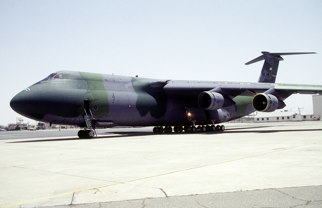 A C-5A Galaxy, 21st Airlift Squadron, Travis Air Force Base, CA, arrives at Biggs Army Airfield loaded with four Army helicopters, two cargo pallets and a government vehicle to be used in Roving Sands '96, the US military's largest annual joint air defense training exercise