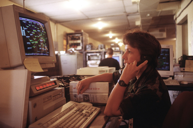 1ST LT. Cindy Krausch of the 157th Air Controllers Group, Jefferson Barracks, St. Louis, Missouri, works as an augmentee to the 612th Air communication Squadron from Davis Monthan Air Force Base, Arizona. The 612th is deployed to El Paso to participate inRoving Sands '96, the US military's largest annual joint air defense training exercise