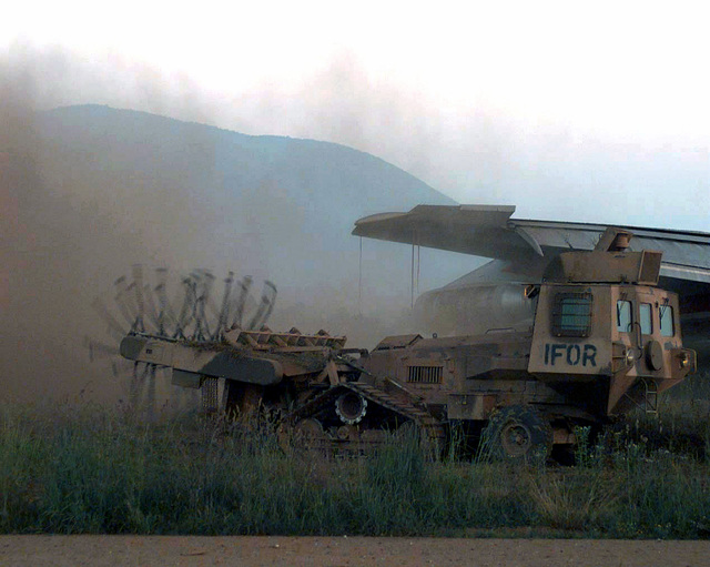 An Aardvark Joint Unit Flail Unit (JSFU) mine clearing vehicle belonging to the French Army Engineers supporting the Peace Implementation Force (IFOR) clears an area adjacent to Sarajevo International Airport. The cleared area will allow an increaing amount of civilian airliners to land in a safer environment. (Duplicate image, see also DD-SD-00-00099 or search 960610-A-3327S-007)