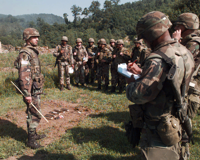 On the afternoon of June 10th, 1996, CPT Timothy Cauley, Commander, C Battery, 4th Battalion, 29th Field Artillery, 2nd Brigade Combat Team, briefs his soldiers about the upcoming live fire exercise in Taszar, Hungary, at lodging area Demi, Serbsca, in support of Operation Joint Endeavor