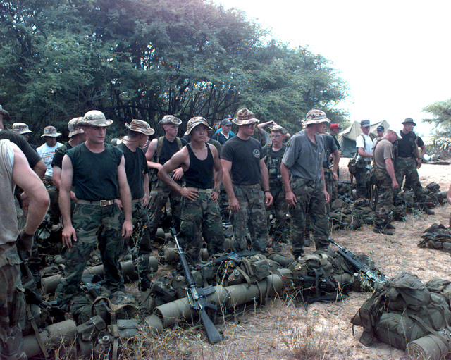 Members of the 1ST Marine Expeditionary Force, G-7, Tactical Exercise Contingency Group with M16 rifles and gear prepare to play the roll of rebel forces and provided resistance to US forces arriving from the sea during RIMPAC '96 taking place at Pacific Missile Range Facility, Barking Sands, Kauai, Hawaii