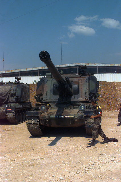Soldiers of the 40th Regiment D'Artillerie, France, on their 155mm AUF-1 Self-propelled Howitzer at Hekon Base, on the outskirts of Mostar