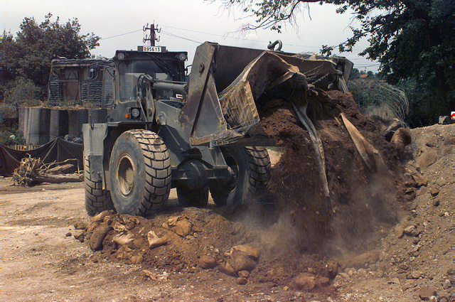 A Belgian engineer operates a Volvo BM 4400 Wheeled Loader to remove existing fortifications as part of a parking area construction project at the Allied Rapid Reaction Corps headquarters (ARRC) in support of Operation JOINT ENDEAVOR (the multi-national peacekeeping mission in Bosnia)