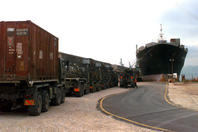 Vehicles of 21 Squadron, Royal Logistics Corps, Abingdon, United Kingdom, wait to be loaded onto the Russian commercial ship Vladimir Vaslyaev for transport home after deployment