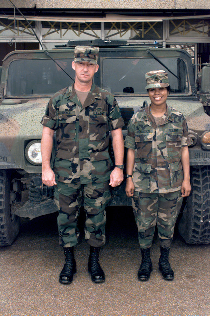 7th Signal Command Sergeant Major Charles Spence poses with Sergeant First Class Elvira Richardson at the Sarajevo Airport