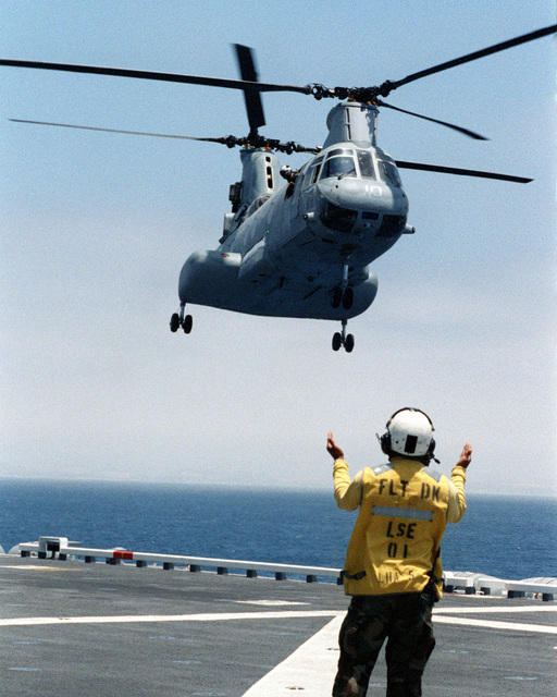 A CH-46 Sea Knight from Marine Medium Helicopter Squadron-164 (HMM-164) (REIN) embarks aboard the USS PELELIU (LHA-5) during Exercise KERNEL BLITZ 97 off the Southern California Coast.  KERNEL BLITZ is a bi-annual Commander-in-CHIEF Pacific (CINCPAC) fleet training exercise (FLEETEX) focused on operational/tactical training of Commander, Third Fleet (C3F)/ I Marine Expeditionary Forces (MEF) and Commander, Amphibious Group 3 (CPG-3)/ 1ST Marine Division (MARDIV).  KERNEL BLITZ is designed to enhance the training of Sailors and Marines in the complexities of brigade-size amphibious assault operations