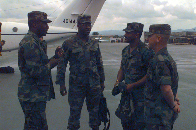 (Left to Right) Sergeant Major of the Army, Gene McKinny; U.S. Army Europe Command Sergeant Major, James McKinny (twin brother to Gene); Command Sergeant Major Spence of the 7th Signal Brigade and Command Sergeant Major Chaney of the 5th Signal Command arrive at the Sarajevo Airport. (SUBSTANDARD IMAGE)