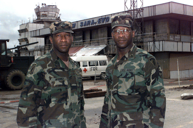Sergeant Major of the Army, Gene McKinney, and his twin brother, the U.S. Army Europe Command Sergeant Major, James McKinney, pose for a photograph at the airport
