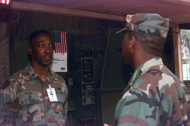Sergeant Major of the Army, Gene McKinney, talks to STAFF Sergeant Young of the 44th Signal Company at the Residency