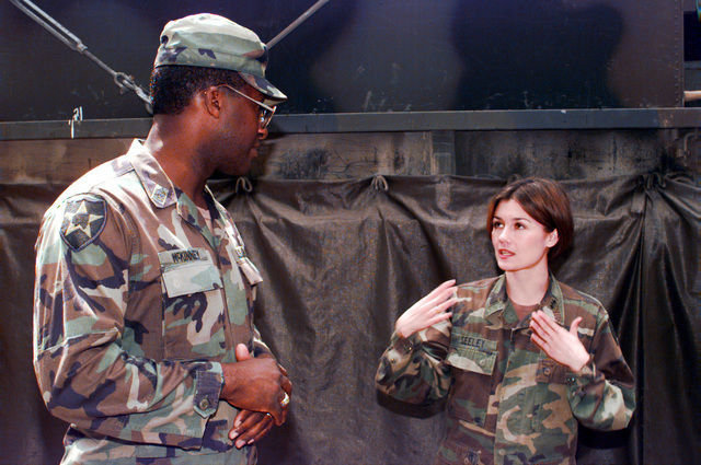 U.S. Army Europe Command Sergeant Major, James McKinney, discusses operations with Lieutenant Tanya Seeley at the LEN 46 Signal Site inside the Allied Command Europe Rapid Reaction Corps compound located in the Sarajevo suburb of Ilidza, Bosnia