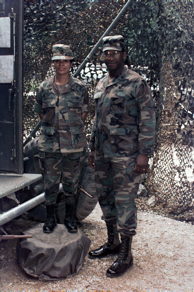 U.S. Army Europe Command Sergeant Major, James McKinney, poses for a photograph with Sergeant First Class Elvira Richardson of the LEN 46 Signal Site