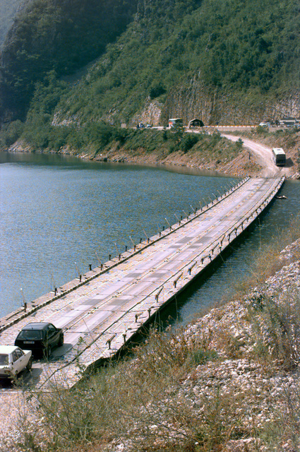 A pontoon bridge replaces a blown out bridge approximately 15 kilometers from Mostar. This is the route buses carrying Serb voters will take to bring them to the polling stations for the elections on 30 June 96