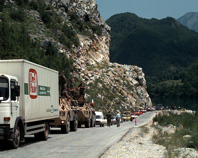 Automobiles backed up on the road to Mostar due to an unannounced road clearing exercise on the eve of the Mostar general elections