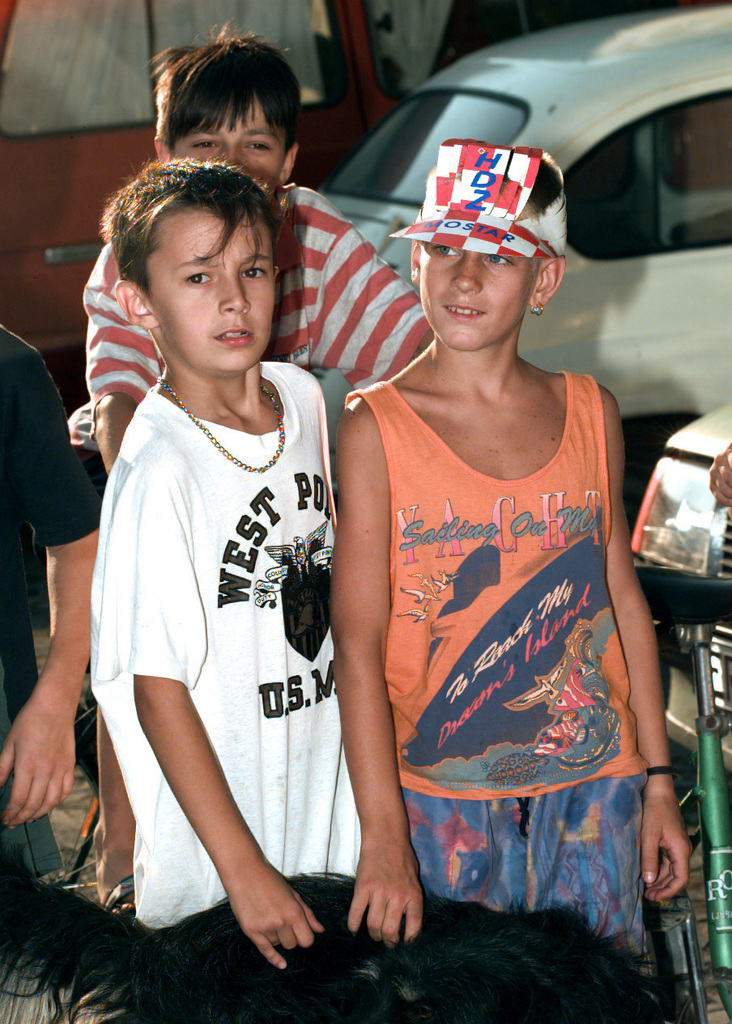Croatian children in western Mostar pose wearing election campaign paraphernalia on the eve of the Bosnian national general elections