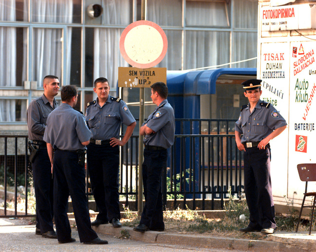 Western Mostar city police officers outside of their police headquarters on the eve of the general elections