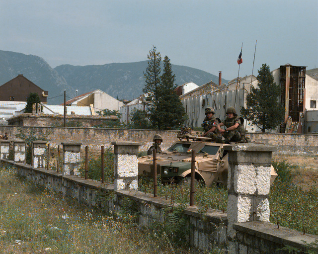 French soldiers atop a French armored car provide security along Mostar route 17 during the day of the Mostar general elections