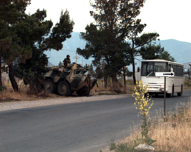 Moroccan soldiers and a Moroccan armored personnel carrier provide security along Mostar Route 17 throughout the day of the Mostar general elections
