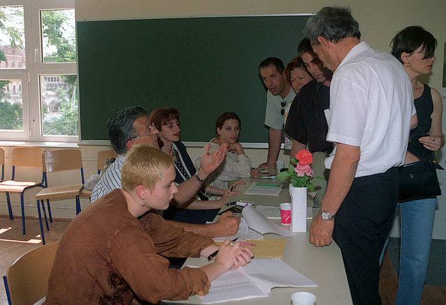 Voters in Mostar begin voting process by registering with voting officials to make sure that they are eligible to vote. Only those residents that were registered during the 1991 Census were allowed to vote. The Mostar elections provided a crucial test for the Dayton Peace Accord which ended the 3 1/2 year war in Bosnia. In accordance with the Dayton Accords, under which Operation JOINT ENDEAVOR (the multi-national peace mission in Bosnia) functions, the provision of a secure environment is at the heart of the reconstruction effort in Bosnia