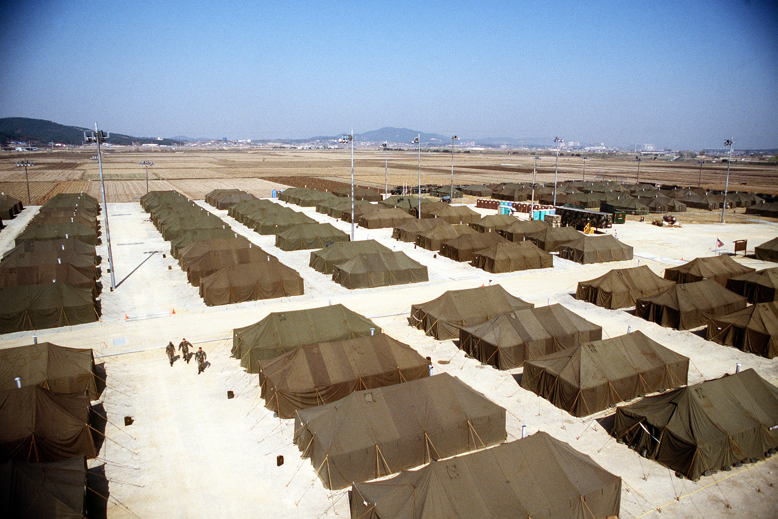 In nine days Air Force and Army civil engineers built this 136-tent village equipped with hot showers, dining hall, recreational facilities, chapel and hospital surrounded by razor-sharp barbed wire and guarded by Army Patriot missiles.Published in AIRMAN Magazine July 1996. Exact Date Shot Unknown