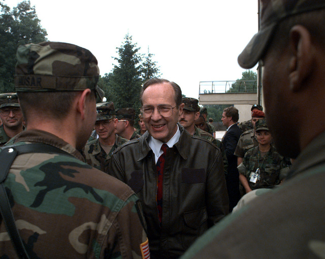 Secretary of Defense, the Honorable William J. Perry, talks informally with soldiers at the Allied Command Europe Rapid Reaction Corps Headquarters in the Sarajevo suburb of Ilidza